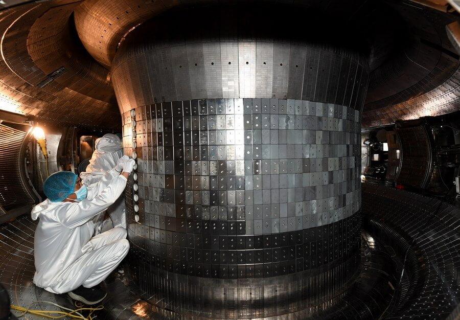 Scientists working inside the experimental advanced superconducting tokamak. Credit: Xinhua/Liu Junxi