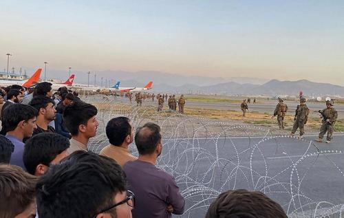 """""""Utter Desperation"""" - Body Count Rises As Terrified Afghans Mob Tarmac At Kabul Airport, Cling To Departing Planes"""
