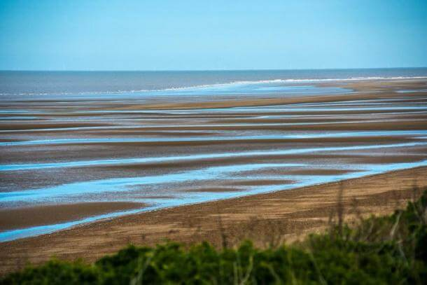Old Hunstanton beach, where Seahenge was found, at low tide in Norfolk, UK. (Andrew/Adobe stock)